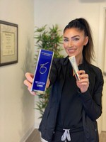 Staff member holding up instant pore product