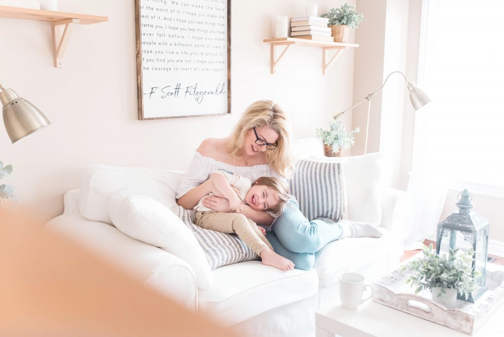 Woman with child in a sunny room